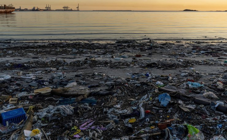 Garbage litters Capurro Beach in the bay of Montevideo, Uruguay, Monday, Dec. 2, 2019. The two-week UN Climate Change Conference COP25 kicked off today in Madrid with urgent calls to make serious progress on climate action. AP