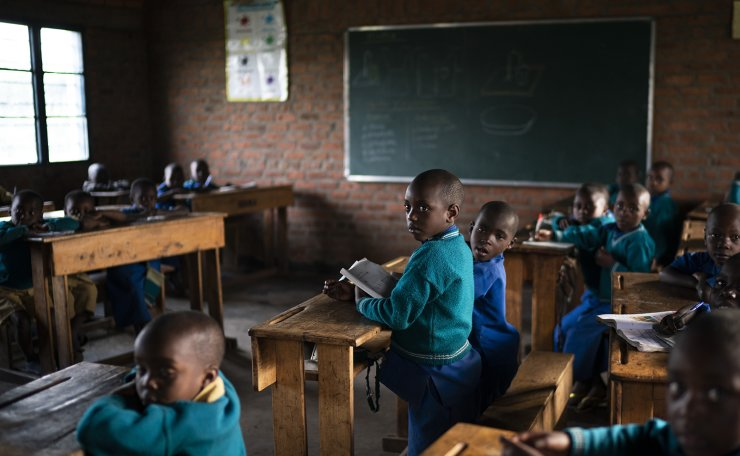 In this Sept. 5, 2019 photo, children attend class at the Nyabitsinde Primary School near the Volcanoes National Park in Kinigi, Rwanda. 'The money that built this school comes from tourism,' says Fabien Uwimana, a French and English teacher. 'More children today can go to school.' AP
