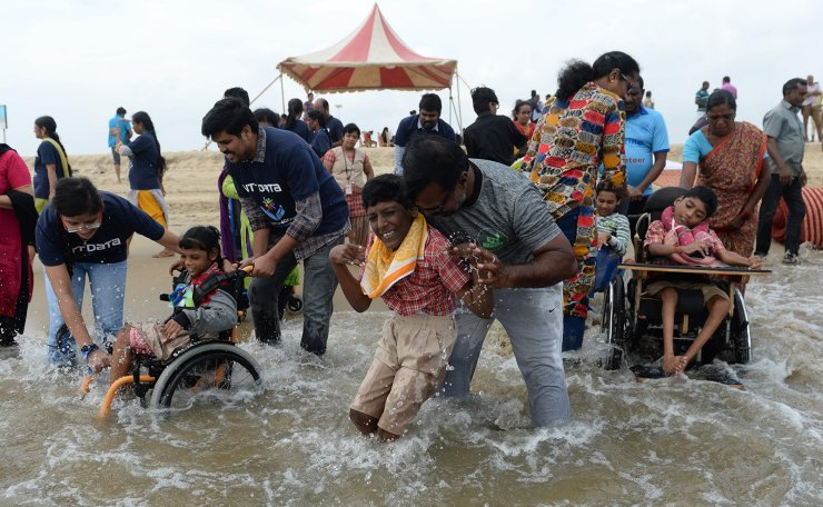 Physically challenged children enjoy at the Marina Beach during an event to mark the International Day of Disabled Persons in Chennai on December 3, 2019. AFP
