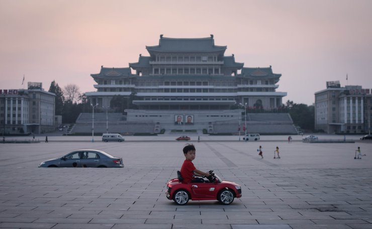 In a photo taken on September 9, 2019 a child drives a miniature electric toy car across Kim Il Sung square in Pyongyang. - North Korea was marking the 71st anniversary of its foundation, with a public holiday. AFP