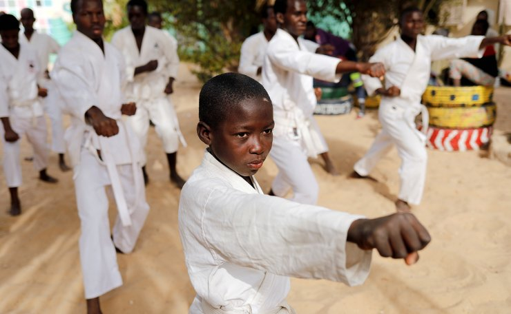 Demba, 8, a Koranic student, called a talibe, attends karate training in the courtyard of Maison de la Gare, an organisation that helps talibe street children reintegrate into society, in Saint-Louis, Senegal, February 8, 2019. Reuters