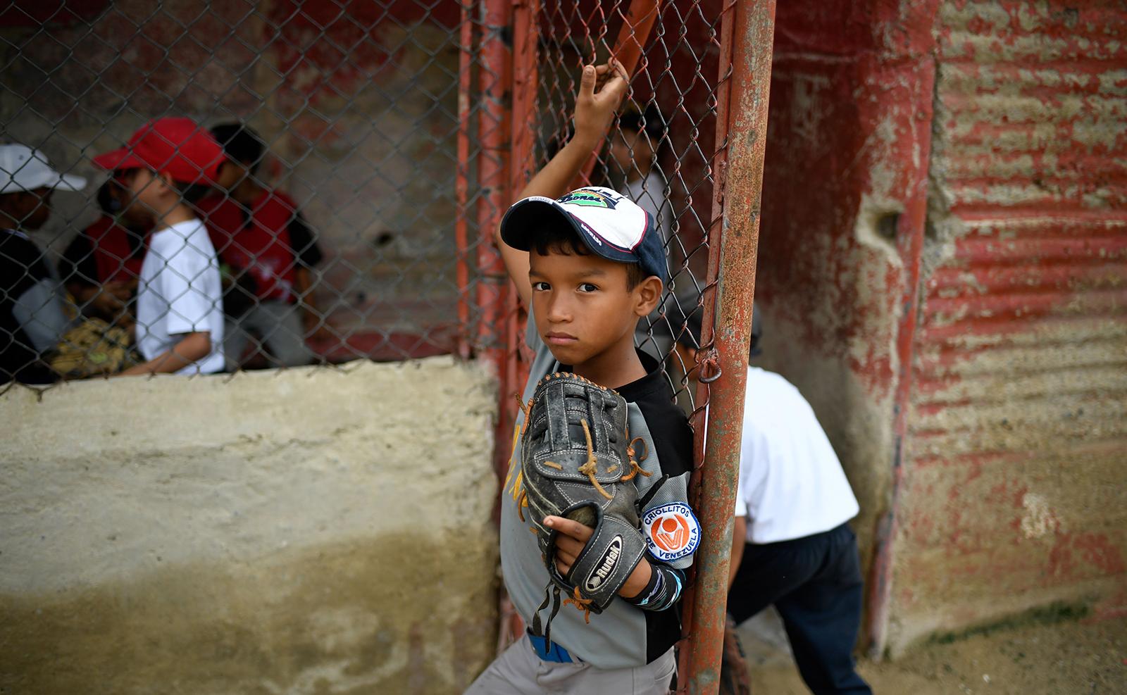 Children attend the opening of a baseball tournament at the Criollitos de Venezuela school in Casalta neighborhood, Caracas, on October 25, 2019. AFP