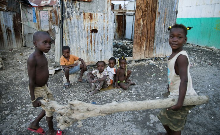 In this Dec. 3, 2019 photo, children play near their home in the Cite Soleil slum of Port-au-Prince, Haiti. According to a joint statement by humanitarian organizations, an estimated 3.7 million Haitians require emergency food assistance. AP