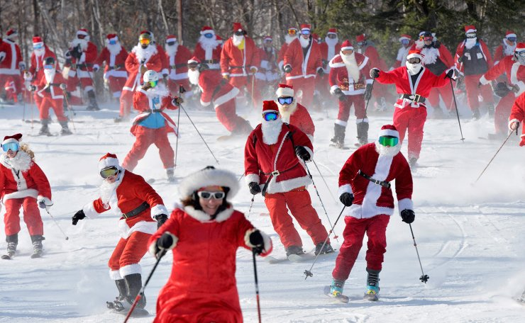 Skiers dressed up as Santa Clause participate in the annual Santa Sunday charity fundraiser skiing event at Sunday River Ski Resort in Newry, Maine on December 8, 2019. - Money raised goes towards the River Fund Charity, a non-profit organization that supports youth education and recreation. AFP