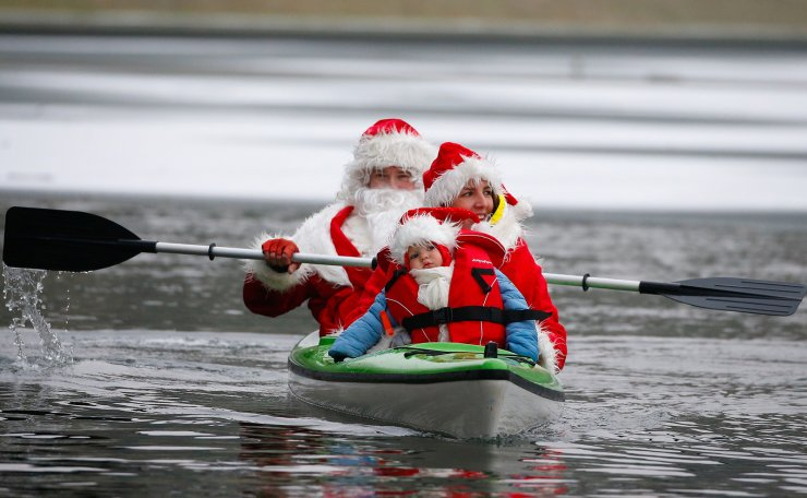 Belarusians dressed as Santa Clauses swim in a kayak during country's Santa Run in Minsk, Belarus December 14, 2019. Reuters