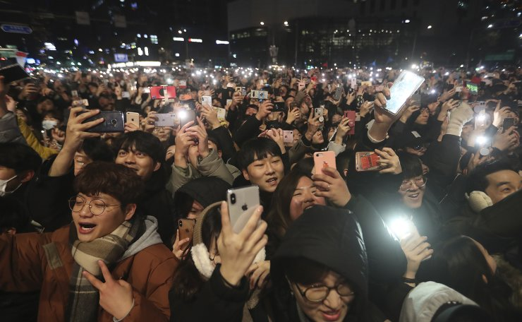 People attend New Year celebrations in Seoul, South Korea, Wednesday, Jan. 1, 2020.  AP