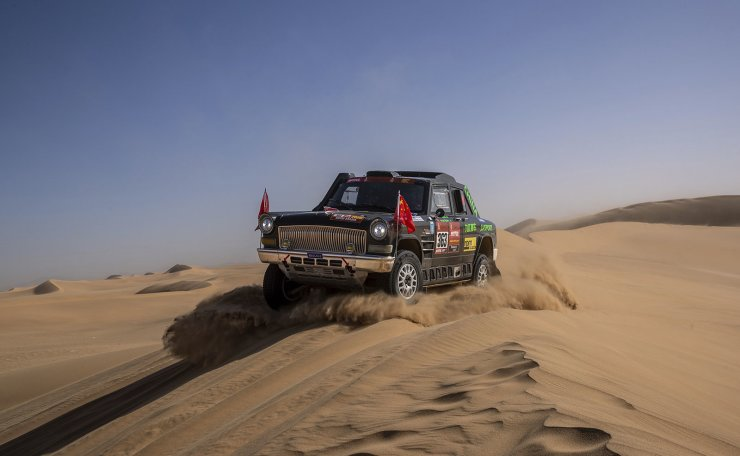 In this Monday, Jan. 13, 2020 photo, driver Quan Ruan, of China, and co-driver Yirong Wang, of China, race their Chevrolet during stage eight of the Dakar Rally in Wadi Al Dawasir, Saudi Arabia. Formerly known as the Paris-Dakar Rally, the race was created by Thierry Sabine after he got lost in the Libyan desert in 1977. Until 2008, the rallies raced across Africa, but threats in Mauritania led organizers to cancel that year's event and move it to South America. It has now shifted to Saudi Arabia. The race started on Jan. 5 with 560 drivers and co-drivers, some on motorbikes, others in cars or in trucks. Only 41 are taking part in the Original category. AP