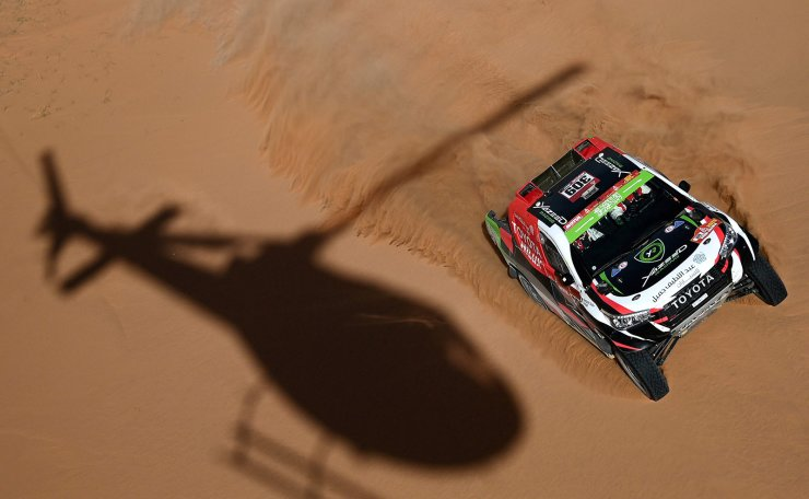 Toyota's Saudi driver Yazeed Al Rajhi and co-driver Russian Konstantin Zhiltsov compete in the Stage 7 of the Dakar 2020 between Riyadh and Wadi Al Dawasir, Saudi Arabia, on January 12, 2020. AFP