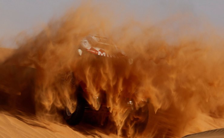 Rallying - Dakar Rally - Stage 7 - Riyadh to Wadi Al Dawasir - Riyadh, Saudi Arabia - January 12, 2020  Bahrain JCW X-Raid Team's Stephane Peterhansel and Paulo Fiuza during stage 7. Reuters