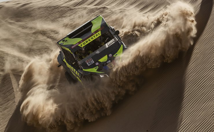 Driver Denis Berezovskiy, of Kazakhstan, and co-driver Adrian Torlaschi, of Argentina, race their Can-Am during stage eight of the Dakar Rally in Wadi Al Dawasir, Saudi Arabia, Monday, Jan. 13, 2020. AP