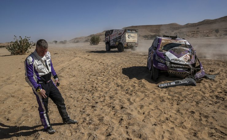 Co-driver Michael Orr, of Great Britain, after crashing his Toyota during stage nine of the Dakar Rally between Wadi Al Dawasir and Haradth, Saudi Arabia, Tuesday, Jan. 14, 2020. AP
