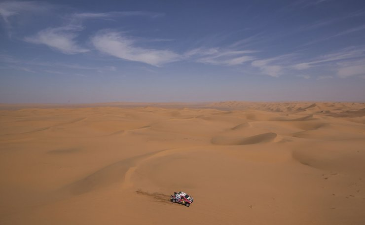 In this Sunday, Jan. 12, 2020 photo, driver Giniel De Villers, of South Africa, and co-driver Alex Haro, of Spain, race their Toyota during stage seven of the Dakar Rally between Riyadh and Wadi Al Dawasir, Saudi Arabia. Formerly known as the Paris-Dakar Rally, the race was created by Thierry Sabine after he got lost in the Libyan desert in 1977. Until 2008, the rallies raced across Africa, but threats in Mauritania led organizers to cancel that year's event and move it to South America. It has now shifted to Saudi Arabia. The race started on Jan. 5 with 560 drivers and co-drivers, some on motorbikes, others in cars or in trucks. Only 41 are taking part in the Original category. AP