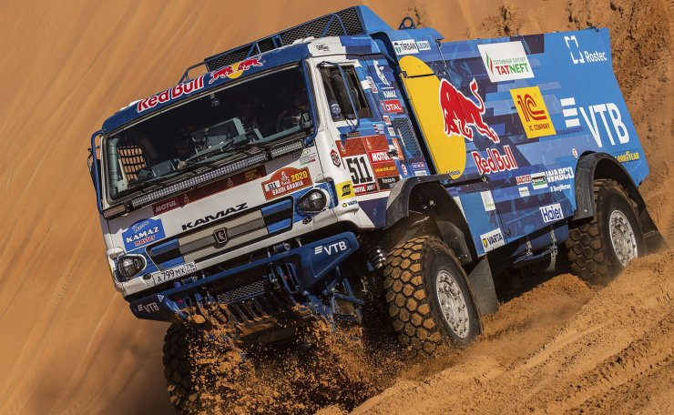 Driver Andrey Karginov, of Russia, and co-drivers Igor Leonov, of Russia, and Andrey Mokeev, of Russia, race their Kamaz truck during stage eleven of the Dakar Rally between Shubaytah and Haradth, Saudi Arabia, Thursday, Jan. 16, 2020. AP