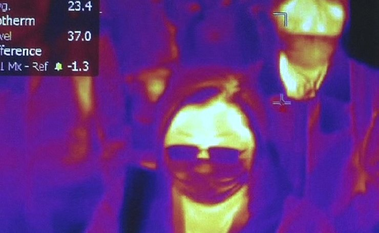 This photo grabbed from a video taken and handout on January 23, 2020 by Rome's Fiumicino Airport Authority (ADR) shows passengers scanned by thermal imaging for body temperature as they go through  health measures and procedures against deadly SARS-like virus outbreak risks, after they landed at Rome's Fiumicino airport on a southern airlines flight from Wuhan, China. AFP