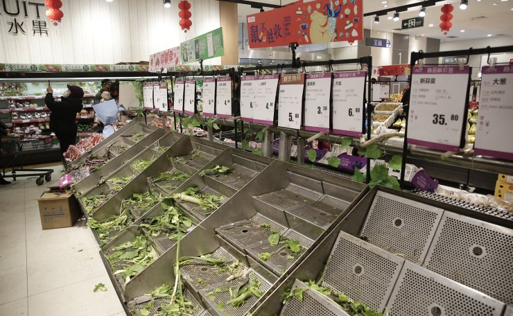 Empty vegetable stalls in a market is seen as people stock up on food due to the coronavirus outbreak in Wuhan City, Hubei Province, China, 23 January 2020. Prices of vegetables and some food soar as people make a run for food and necessities after authorities imposed a complete travel ban in Wuhan 23 January in an effort to contain the spread of the virus. EPA