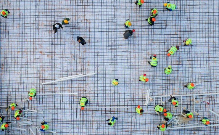 <span>Aerial photo taken on Jan. 28, 2020 shows laborers working at the construction site of Huoshenshan Hospital in Wuhan, central China's Hubei Province.The construction of Huoshenshan Hospital, a makeshift hospital for treating patients infected with the novel coronavirus, is underway in Wuhan. Xinhua</span><br /><br />