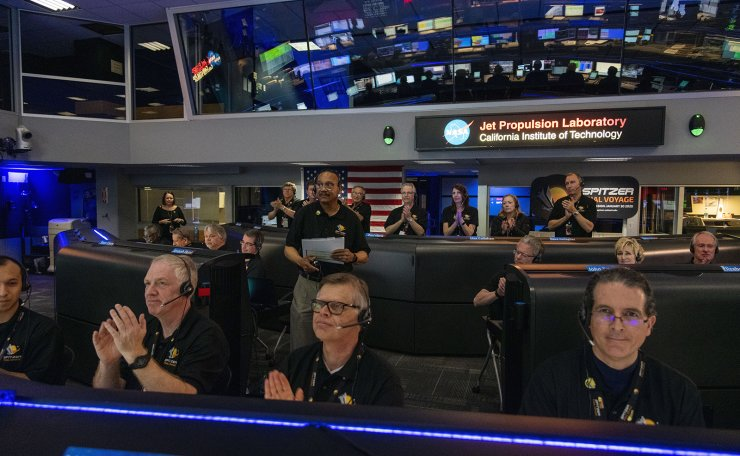 A handout photo made available by the National Aeronautics and Space Administration (NASA) shows Spitzer Project Manager Joseph Hunt (C, back) standing in Mission Control at NASA's Jet Propulsion Laboratory (JPL) in Pasadena, California, USA, 30 January 2020 (issued 01 February 2020), declaring the spacecraft decommissioned and the Spitzer mission concluded. EPA/NASA/JPL-CALTECH HANDOUT