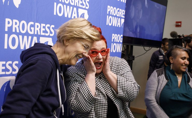 US democratic presidential candidate Elizabeth Warren (L) reacts while taking a photo with supporter Heather Ryan during a Super Bowl watch party in Des Moines, Iowa, USA, 02 February 2020. The first-in-the-nation Iowa caucuses are on 03 February 2020.  EPA