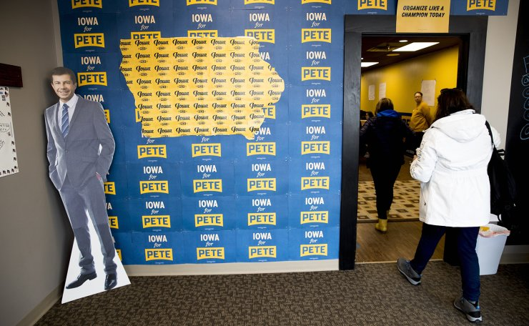 A cutout of Democratic presidential candidate former South Bend, Ind., Mayor Pete Buttigieg, left, is displayed at a campaign office the day of the Iowa Caucus, Monday, Feb. 3, 2020, in West Des Moines, Iowa. AP