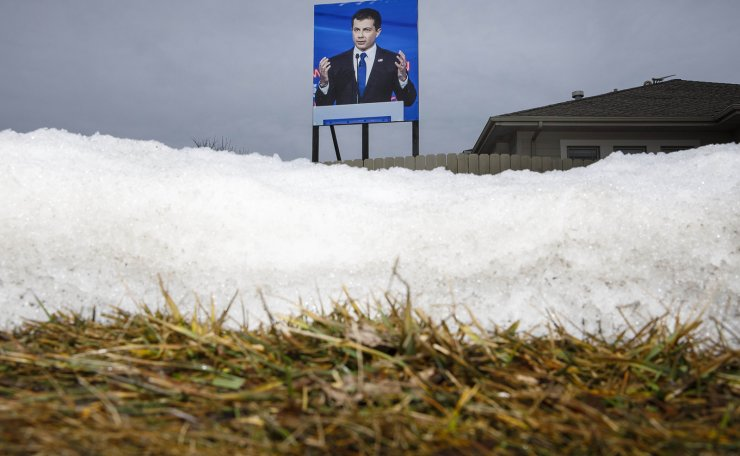 A billboard of Democratic presidential candidate former South Bend, Indiana Mayor Pete Buttigieg is displayed in the backyard of George Davey's home on February 03, 2020 in West Des Moines, Iowa. During the previous Presidential election, Davey had placed a billboard of then candidate President Donald Trump in the same location. AFP