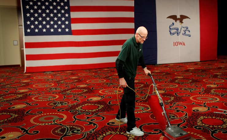 Worker Joe Robinson vacuums at the site of Democratic U.S. presidential candidate Senator Bernie Sanders' Caucus night rally in Des Moines, Iowa, U.S., February 3, 2020. Reuters