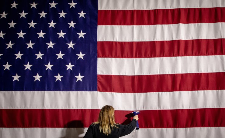 Amy Pfeiffer, an executive assistant from Production Management One, irons a US flag in advance of the Pete for America caucus night watch party in the first-in-the-nation Iowa caucus for the 2020 Democratic presidential race at Drake University Bell Center in Des Moines, Iowa, USA, 03 February 2020. EPA