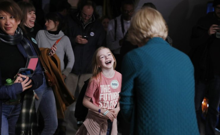 Democratic presidential candidate Sen. Elizabeth Warren, D-Mass., visits with a young supporter at a caucus at Roosevelt Hight School, Monday, Feb. 3, 2020, in Des Moines, Iowa. AP
