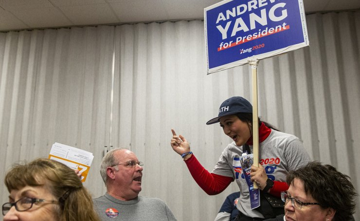 Joelle Tessari, of Los Angeles, precinct captain for the Andrew Yang campaign, tries to appeal to Steve Poulsen of West Liberty, a Biden supporter, after seeing that former Vice President Joe Biden will not be a viable candidate at their caucus site, Monday, Feb. 3, 2020, in West Liberty, Iowa. AP