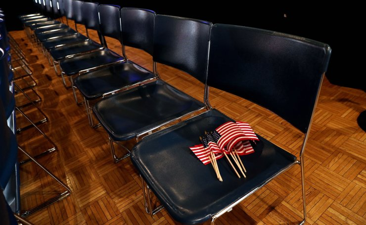 Flags are left on a seat before a rally by former Vice President Joe Biden in Des Moines, Iowa, U.S., February 3, 2020. Reuters
