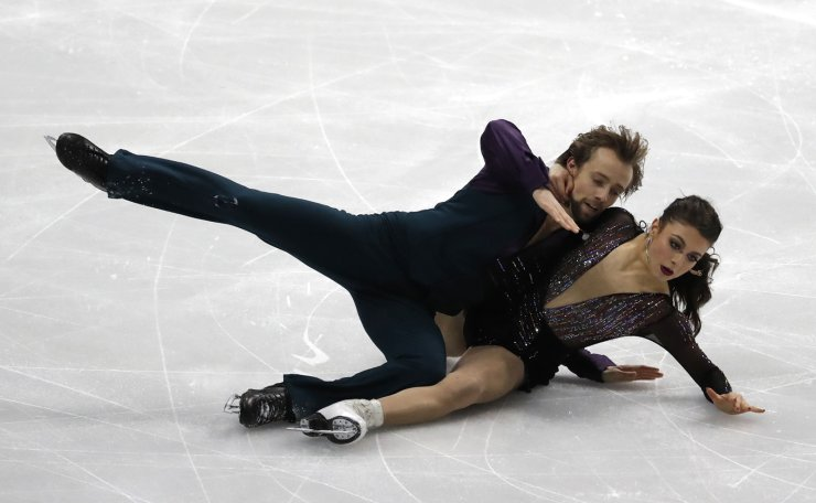 United States' Kaitlin Hawayek and Jean-Luc Baker fall as they perform during the Ice Dance Rhythm Dance competition in the ISU Four Continents Figure Skating Championships in Seoul, South Korea, Thursday, Feb. 6, 2020. AP