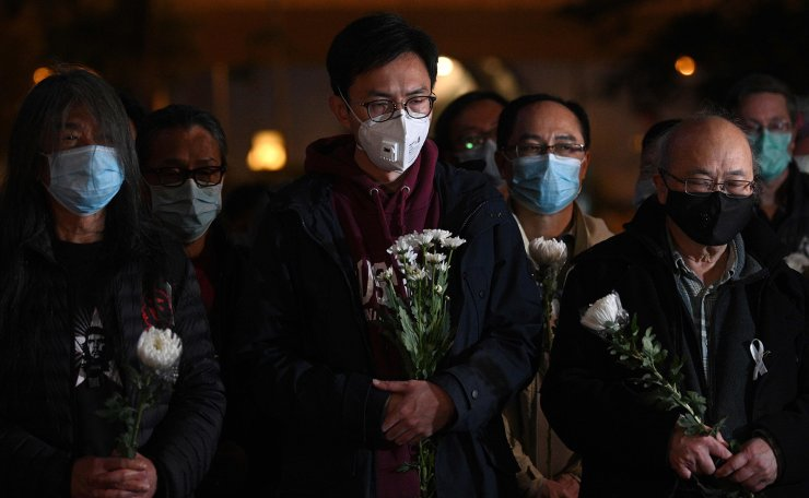 People attend a vigil in Hong Kong on February 7, 2020 for novel coronavirus whistleblowing doctor Li Wenliang, 34,?who died in Wuhan after contracting the virus while treating a patient.  AFP