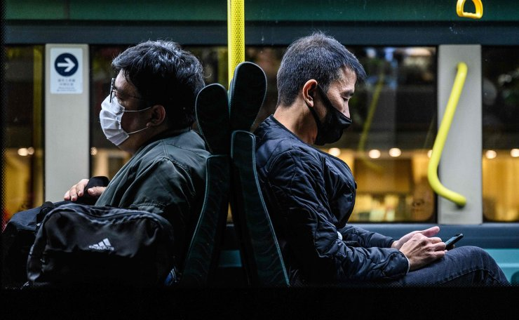 This photo taken on February 6, 2020, shows passengers on board a bus shortly before their departure from Tuen Mun in Hong Kong to Shenzhen, via the Shenzhen Bay Bridge. AFP