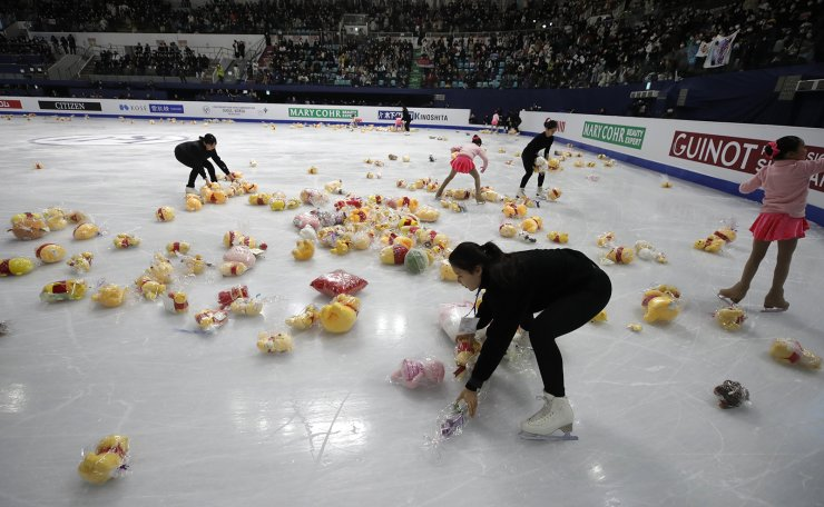 Gifts thrown by supporters of Japan's Yuzuru Hanyu, are picked up from the ice during the men's single free skating competition in the ISU Four Continents Figure Skating Championships in Seoul, South Korea, Sunday, Feb. 9, 2020. AP