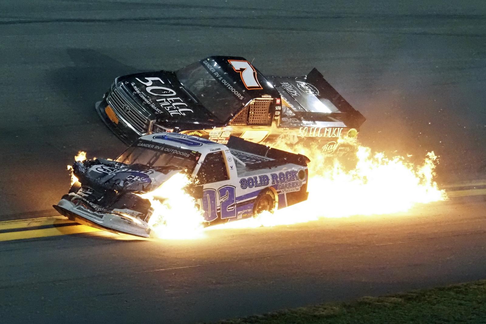 Tate Fogleman (02) and Korbin Forrister (7) crash between turns 3 and 4 during the NASCAR Truck Series auto race at Daytona International Speedway, Friday, Feb. 14, 2020, in Daytona Beach, Fla. AP
