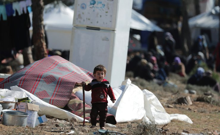 An internally displaced child walks at a makeshift camp in Qatmah village, West of Azaz, Syria February 17, 2020. Reuters