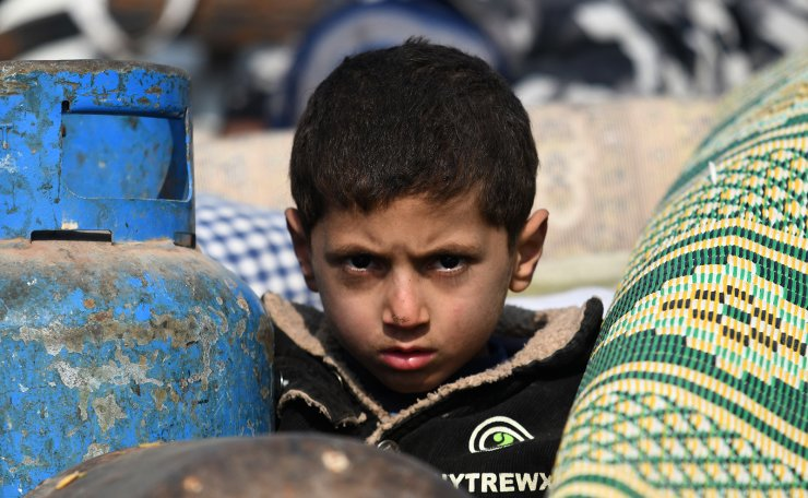 An internally-displaced Syrian boy is pictured in a camp in Sarmada in the north of Syria's northwestern Idlib province on February 17, 2020. AFP
