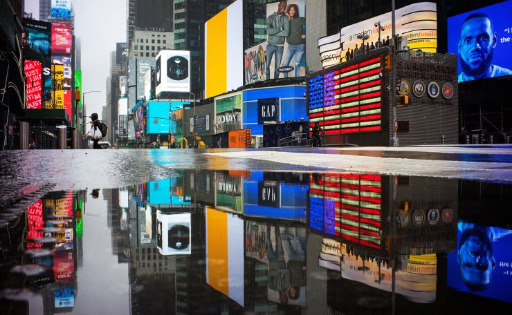 A man crosses 7av in an empty Times Square as the coronavirus disease (COVID-19) outbreak continues in New York City, U.S., March 29, 2020. Reuters