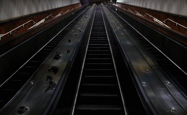 A view of an empty escalator inside MBTA Porter Square station on March 29, 2020 in Cambridge, Massachusetts. AFP