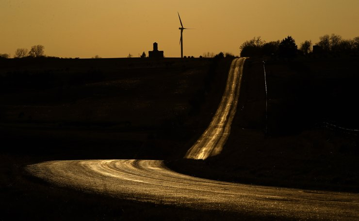 An empty country road glows as the sun sets, Sunday, March 29, 2020, near King City, Mo., as people stay at home in order to help stem the spread of the new coronavirus. AP