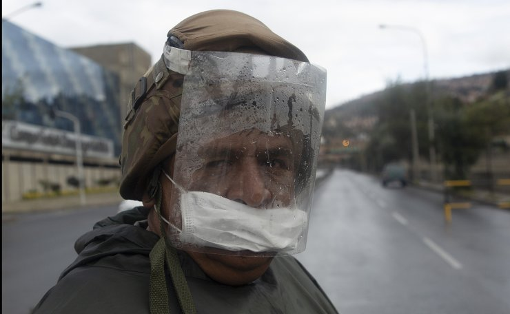 A soldier patrols an empty road amid government restrictions that limit residents, based on their national ID number, to essential shopping in the morning in an attempt to contain the spread of the new coronavirus in La Paz, Bolivia, Monday, March 30, 2020. AP