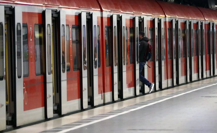 A man enters a train at an empty platform downtown in Munich, Germany, Monday, March 30, 2020. AP