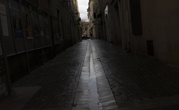 An empty street after being sprayed with disinfectant as a precautionary measure against coronavirus, during a nationwide confinement to control the spread of the virus, in Aubagne, southern France, Tuesday, March 31, 2020. AP