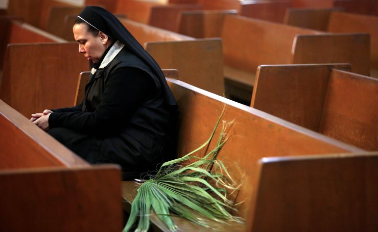 A nun sits at an empty church during Palm Sunday, after Mexico's government declared a health emergency and issued stricter rules to contain the spread of the coronavirus disease (COVID-19), in Ciudad Juarez, Mexico April 5, 2020. Reuters