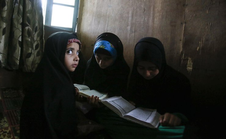 Kashmiri Muslim children attend recitation classes of the holy Quran on the first day of the fasting month of Ramadan in Srinagar, Indian controlled Kashmir, May 7, 2019. AP