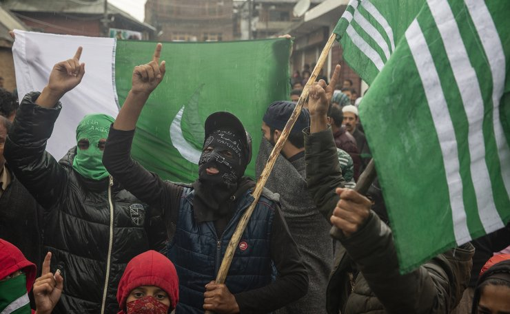 Masked Kashmiris shout slogans during a protest after Friday prayers on the outskirts of Srinagar, Indian controlled Kashmir, Oct. 4, 2019. AP