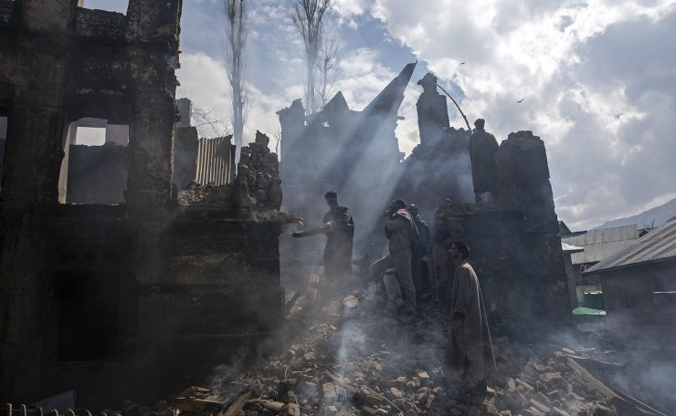 Kashmiri men dismantle a portion of a house destroyed in a gunbattle in Tral village, south of Srinagar, Indian controlled Kashmir, March 4, 2019. The image was part of a series of photographs by Associated Press photographers which won the 2020 Pulitzer Prize for Feature Photography. AP