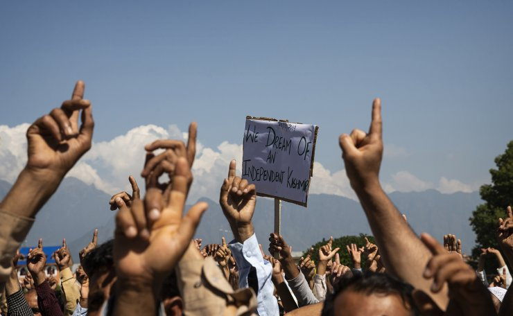 Kashmiri men shout freedom slogans during a protest against New Delhi's tightened grip on the disputed region, after Friday prayers on the outskirts of Srinagar, Indian controlled Kashmir, Aug. 23, 2019. AP