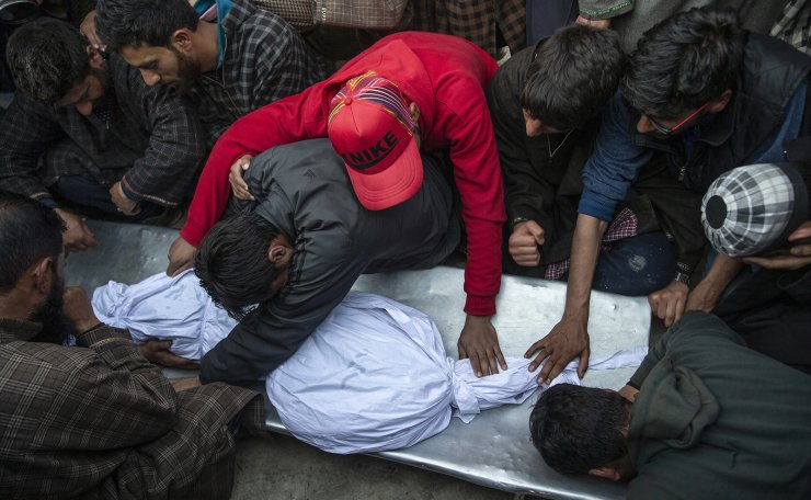 Kashmiri villagers grieve near the body of an 11-year-old boy, Aatif Mir, during his funeral procession in Hajin village, north of Srinagar Indian controlled Kashmir, March 22, 2019. Indian security forces killed five militants and the 11-year-old hostage in three separate clashes in the Indian-controlled portion of Kashmir. AP