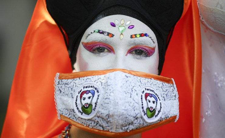A participant wears a face mask at the 'Pride Berlin' demonstration in Berlin, Germany, 27 June 2020. A large crowd marched under the motto 'Save our Community, Save our Pride' in solidarity with the hardships of the German capital's LGBTIQ community but also in Poland, Russia, and Ukraine. Berlin's world-famous pride parade, Christopher Street Day (CSD), which was to take place at the end of July, was canceled this year due to the ongoing pandemic of the COVID-19 disease caused by the SARS-CoV-2 coronavirus. EPA