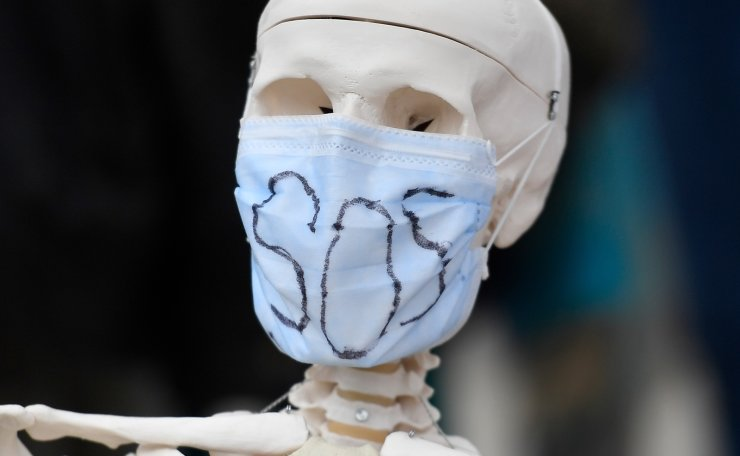 A fake skeleton bearing a face mask is seen as health workers demonstrate in Rennes, western France, on June 30, 2020, as part of a nationwide day of protests to demand better working conditions. AFP